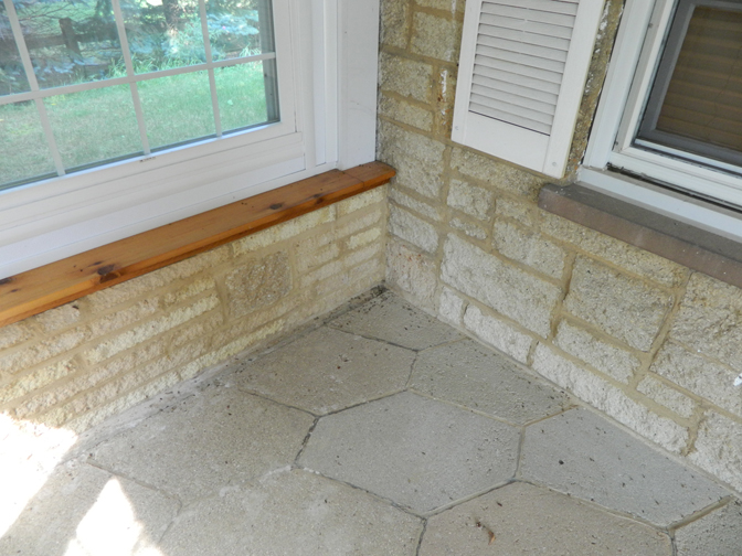 Split rock sample on building's porch.